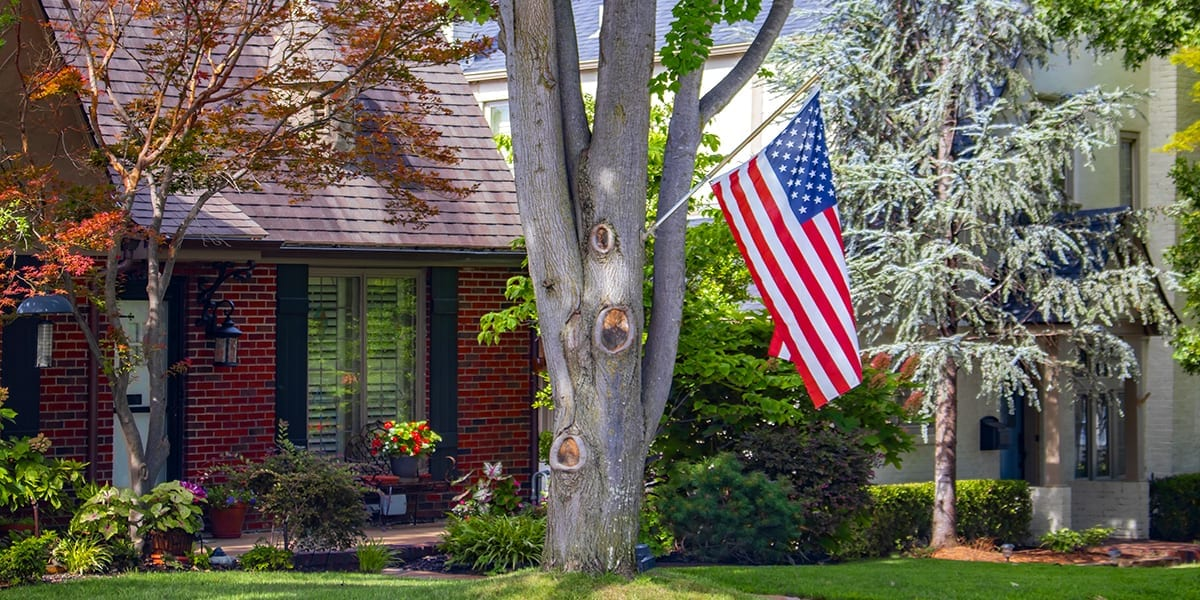 advantages-of-big-trees-brick-house-american-flag